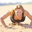 Stock Photo: Young fit girl doing push ups