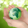 Green earth on palm — Stock Photo