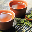 Chinese tea on bamboo mat — Stock Photo #6432735