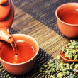 Chinese tea on bamboo mat — Stock Photo