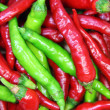 Red and green hot pepper background — Stock Photo