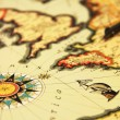 Ancient world map and compass — Stock Photo
