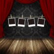Blank photo frames hanging against retro theater background - Stock Photo