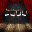 Blank photo frames hanging against retro theater background — Stock Photo