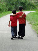 Two boys walking along a path — Stok fotoğraf