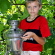 Stock Photo: Boy with samovar.