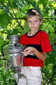 The boy with a samovar. — Stock Photo