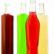 Bottles glass with multi-colored lemonade — Stock Photo #5502572