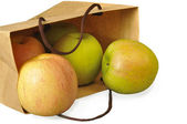 Apples in a paper package — Stock Photo