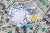 Drugs and money — Stock Photo