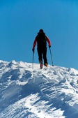 Skier in high mountain — Stock Photo
