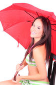 Girl with red umbrella — Stock Photo