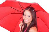 Beautiful girl holding a red umbrella — Stock Photo