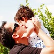 Father gives a kiss to his daugther — Stock Photo