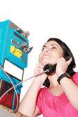 Beautiful woman happy talking on the public phone — Stock Photo