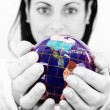 Woman holding the world in her hands — Stock Photo