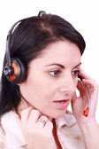 Young telephonist speaking on a headset — Stock Photo