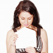 Young beautiful woman opening a letter isolated on a white background — Stock Photo #5935228