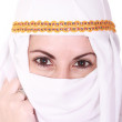Beautiful young arabic woman Middle East in the national headdress — Stock Photo