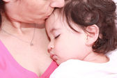 Woman with sleeping baby — Stock Photo