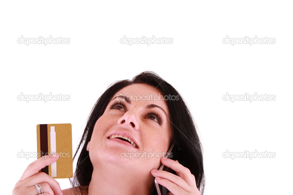 Young woman holding credit card looking up  — Stock Photo #6581530