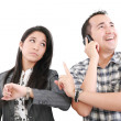 Stock Photo: Give me one minute, caucasimid adult person talking on cellph