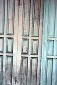 Wooden door with a faded paint — Stock Photo