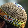 Stock Photo: Indonesitypical cap made from wicker decorated with beads
