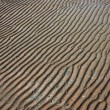 Patterns of sand on the seashore are receding — Stock Photo