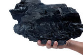 Male hand holding a big lump of coal — Stock Photo
