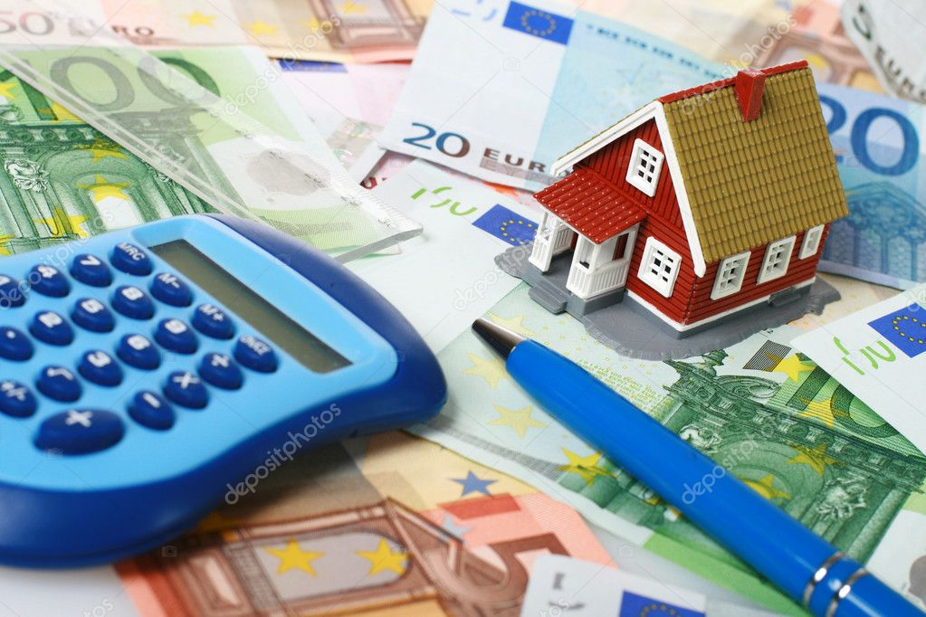 Small house, calculator and pen over euro money background.  Stock Photo #6573549