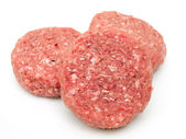 Raw beef burgers close up on white — Stock Photo
