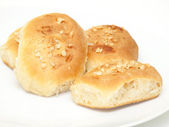 Four fresh home baked buns with chopped nuts — Stock Photo