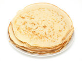Plain homemade pancakes against white — Stock Photo