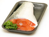 Piece of fresh raw salmon with parsley on a tray isolated on whi — Stock Photo