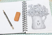 Pencil stetch of vase with flowers in a notebook — Stock Photo
