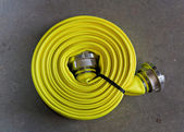 Yellow fire hose — Stock Photo