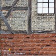 Stock Photo: Old brick wall with framework