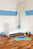 Baby nursery with bed — Stock Photo