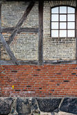Old brick wall with framework — Stock Photo