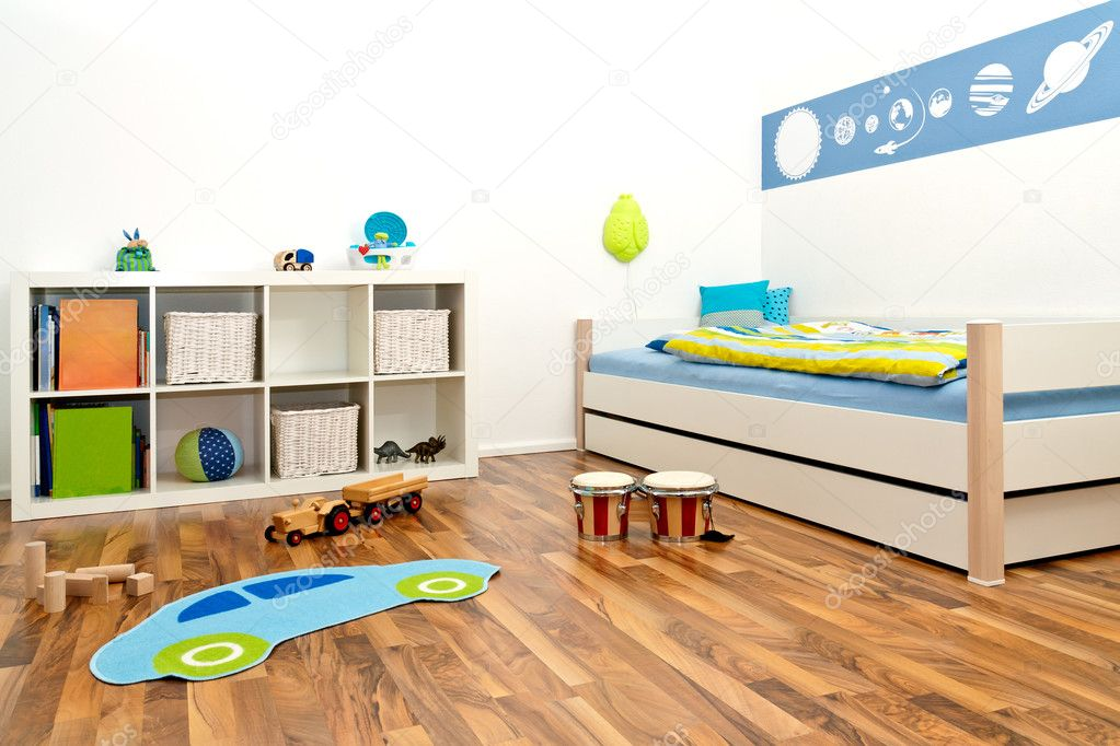 Childrens Playroom with bed and rack and some toys — Stock Photo #5713939