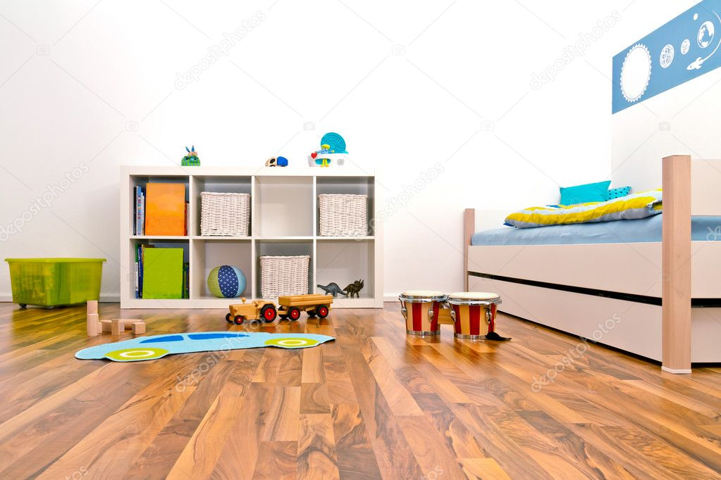 Children's Playroom with bed and rack and some toys — Stock Photo #5713954
