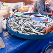 Selling fish at a bazar - Stock Photo