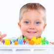 Little cute boy playing with multicolored mosaic — Stock Photo