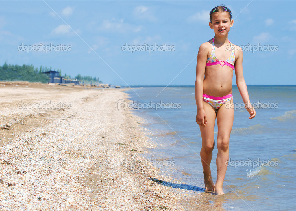 happy pretty beautiful girl running on beach stock photo mac sim 5423299. Black Bedroom Furniture Sets. Home Design Ideas