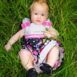 Stock Photo: Beautiful little girl lying in grass