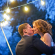 Newlyweds. Romantic Honeymoon dance with lanterns — Stock Photo