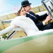 newlyweds in wedding car — Stock Photo