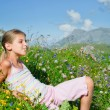 Girl lying in a meadow backround Alps — Stock Photo