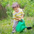Stock Photo: Young Boy In The Garden